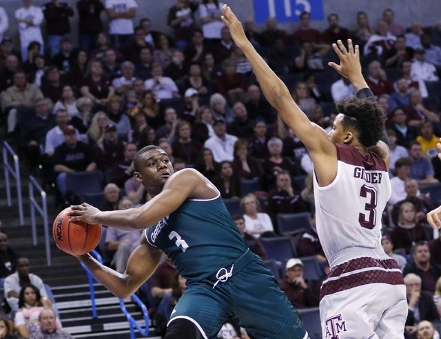 Green Bay guard Khalil Small (3) passes around Texas A&M guard Admon Gilder (3) in the first half of a first-round men's college basketball game in the NCAA Tournament, Friday, March 18, 2016, ...