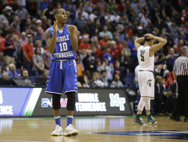 Middle Tennessee's Jaqawn Raymond, left, celebrates as Michigan State's Bryn Forbes walks away late in the second half of a first-round men's college basketball game in the NCAA tournament, Friday ...