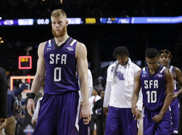 Stephen F. Austin's Thomas Walkup (0) and Trey Pinkney (10) leave the court after a second-round men's college basketball game against Notre Dame in the NCAA Tournament, Sunday, March 20, 2016, in ...