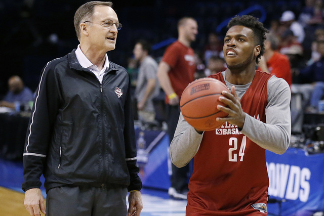 Oklahoma head coach Lon Kruger, left, talks with guard Buddy Hield (24) as he shoots during a practice for a first round men's college basketball game in the NCAA Tournament, Thursday, March 17, 2 ...