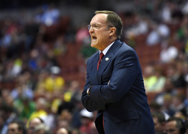 Oklahoma head coach Lon Kruger yells to his team during the first half of an NCAA college basketball game against Texas A&M in the regional semifinals of the NCAA Tournament, Thursday, March 2 ...