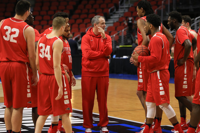 Stony Brook coach Steve Pikiell, center, gathers his players during practice ahead of a first-round men's college basketball game in the NCAA Tournament in Des Moines, Iowa, Wednesday, March 16, 2 ...
