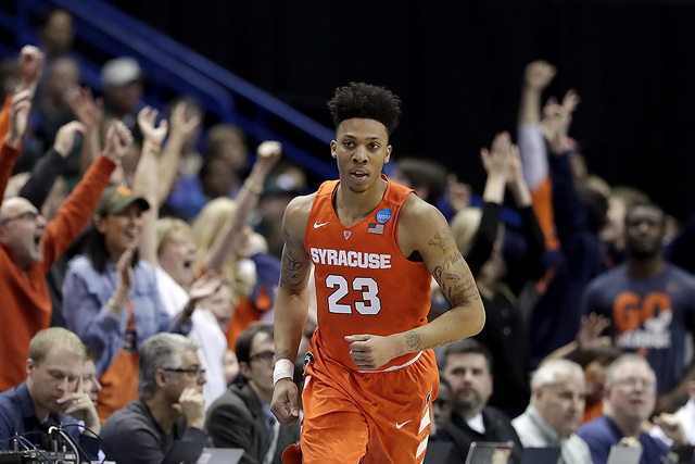 Syracuse's Malachi Richardson celebrates after making a basket during the second half of a first-round men's college basketball game against Dayton in the NCAA Tournament, Friday, March 18, 2016,  ...