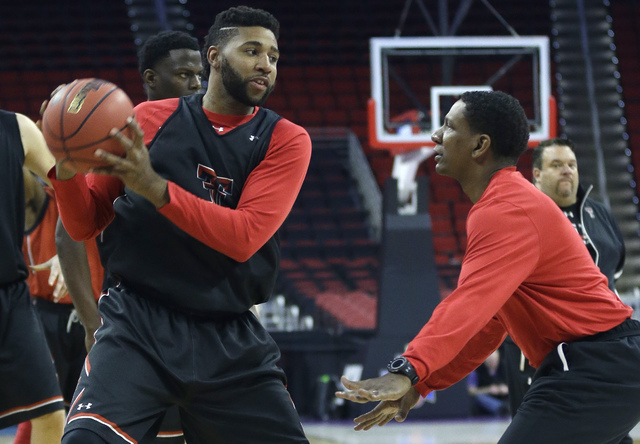 Texas Tech's Aaron Ross, left, participates in a drill with assistant coach Pooh Williamson during practice for a first-round men's college basketball game in the NCAA Tournament  in Raleigh, N.C. ...