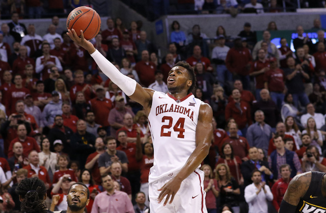 Oklahoma guard Buddy Hield (24) goes up for a basket against VCU in the second half during a second-round men's college basketball game in the NCAA Tournament in Oklahoma City, Sunday, March 20, 2 ...