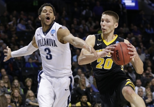 Iowa's Jarrod Uthoff (20) and Villanova's Josh Hart (3) fight for the ball during the first half of a second-round men's college basketball game in the NCAA Tournament, Sunday, March 20, 2016, in  ...