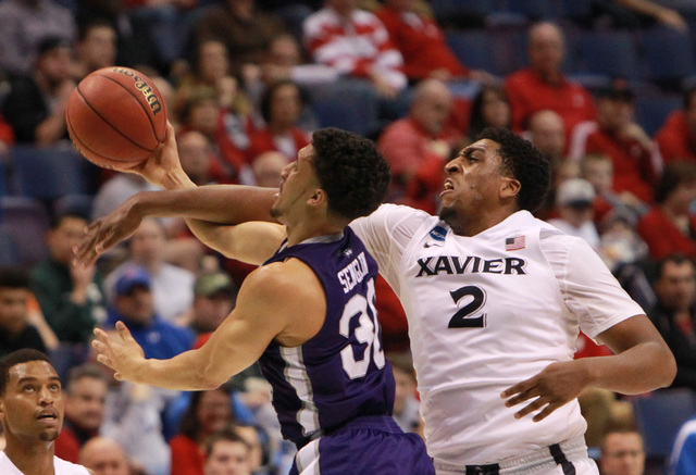 Xavier forward James Farr, right, fouls Weber State guard Jeremy Senglin during the first half of an NCAA college basketball game in the NCAA men's tournament, Friday, March 18, 2016, in St. Louis ...