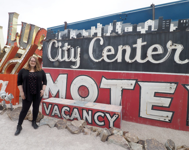 Maggie Zakri, collections manager at the Neon Museum, poses next to a Betty Willis-designed sign highlighted in March for Women's History Month. Jerry Henkel/Las Vegas Review-Journal