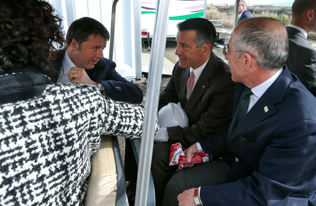 Italy's Prime Minister Matteo Renzi, second from left, his wife, Agnese, Nevada Gov. Brian Sandoval, second from right, and Enel CEO Francesco Starace prepare for a tour of Enel Green Power North  ...