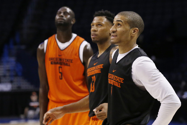 Oregon State center Cheikh N'diaye (5), guard Langston Morris-Walker, center, and guard Gary Payton II (1) watch a fouls shot during a practice for a first round men's college basketball game in t ...