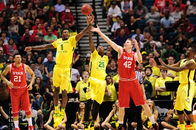Oregon forward Jordan Bell (1) intercepts a pass in front of Utah forward Jakob Poeltl (42) and forward Chris Boucher (25) in the first half of the Pac 12 Conference tournament championship game a ...