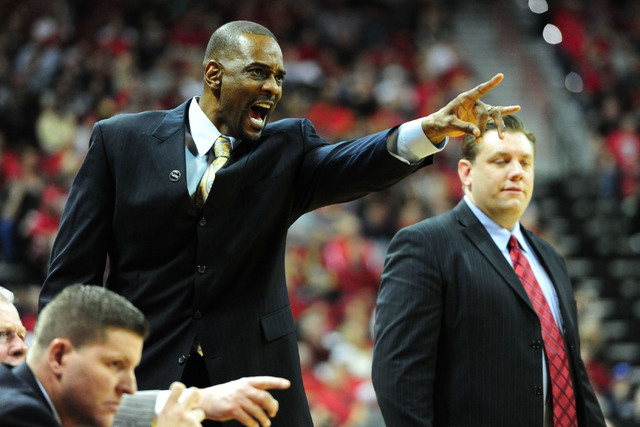 UNLV assistant head coach Stacey Augmon is seen in the second half of their NCAA college basketball game against San Diego State at the Thomas & Mack Center in Las Vegas on Saturday, Jan. 30,  ...