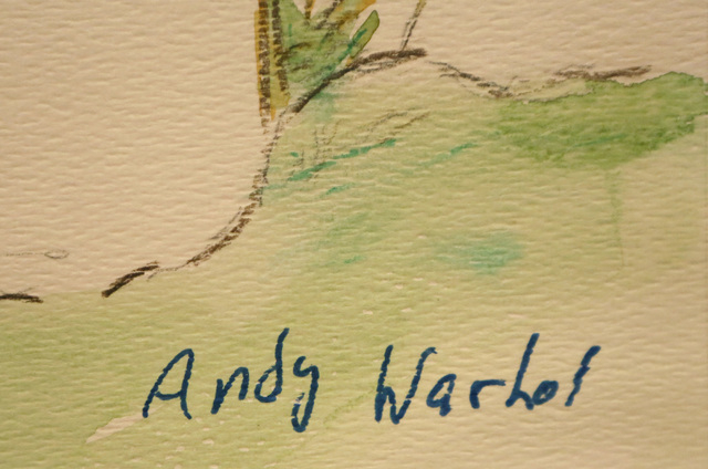 A close-up and artist signature is shown Thursday, March 17, 2016, on a painting that is believed by its owner to be an original early work of Andy Warhol. James Samaniego claims he found the pain ...