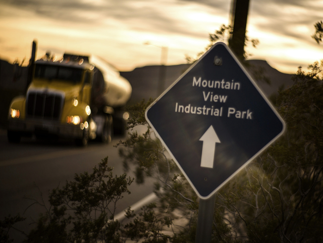 A tanker truck passes a sign, Wednesday, Dec. 9, 2015, near were the proposed Faraday Future auto plant will be built. Gov. Brian Sandoval will announce Thursday in Las Vegas that the electric car ...