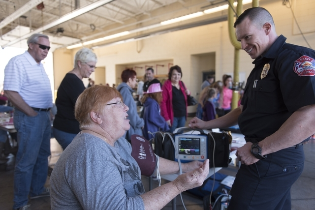 Linda Loyas, left, has her blood pressure taken by firefighter Jeremy Avila during a pancake breakfast event at North Las Vegas Fire Department's Fire Station 56 at 3475 Elkhorn Road, Saturday, Fe ...