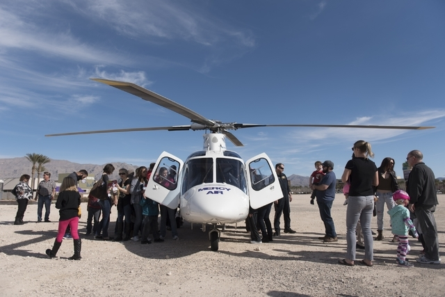 The community explores a helicopter during a pancake breakfast event in a lot adjacent to North Las Vegas Fire Department's Fire Station 56 at 3475 Elkhorn Road, Saturday, Feb. 13, 2016. (Jason Og ...