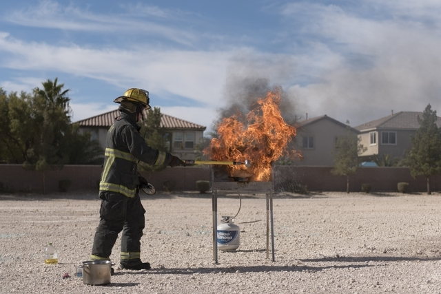 Firefighter/paramedic Scott Nielsen demonstrates what happens when you throw water on a grease fire during a pancake breakfast event at North Las Vegas Fire Department's Fire Station 56 at 3475 El ...