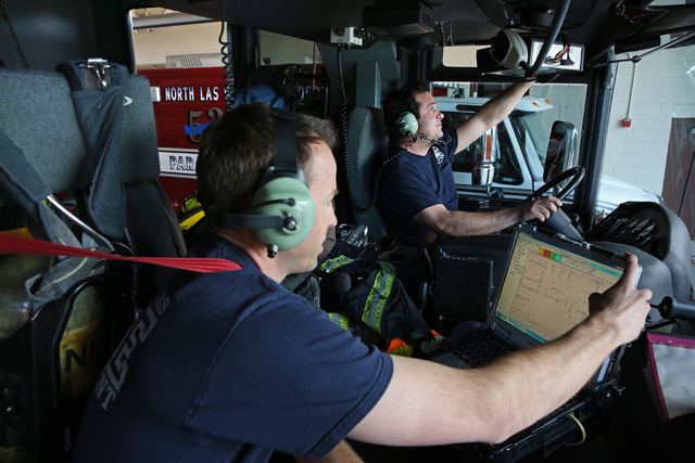 Capt. Aric Neuharth, left, and engineer Troy Henderson prepare to respond to a medical call at the North Las Vegas Fire Department Station 53 on Sunday, March 6, 2016. (Benjamin Hager/Las Vegas Re ...