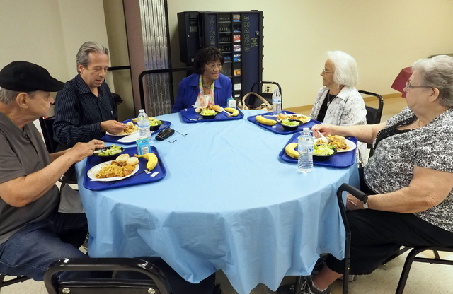 A group of seniors sit down for lunch at the Holy Spirit Lutheran Church March 2. Seated from left are John McNown, 79; Abraham Amaya, 62; Ruby Collins, 86; Ilene Greenwald, 94; and Mable Hooper,  ...