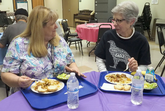 Loretta Block, 62, chats with Janice Schrumm, 74, during lunch at Holy Spirit Lutheran Church March 2. Jerry Henkel/View