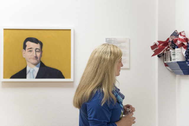 "Kathy Heintz views the ""MUG SHOTS #3"" group show at Left of Center Art Gallery, 2207 W. Gowan Road in North Las Vegas, March 12. Jason Ogulnik/View"