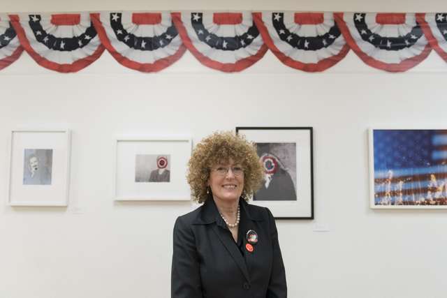 """Artist and curator Diane Bush poses at the """"MUG SHOTS #3"""" group show at Left of Center Art Gallery March 12. Jason Ogulnik/View"""