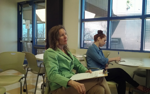 Left, Suzanne Lea, a Summerlin resident and the founder and CEO of In12Days, and Rose Donahue, an In12Days volunteer, listen during a build-out meeting Feb. 16 in the Cirque du Soleil cafeteria. T ...