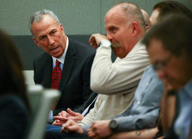 Clark County District Attorney Steve Wolfson, left, talks as Bob Meyers while Erich Nowsch, not pictured, pleads guilty to the murder of Tammy Meyers, wife of Bob Meyers, at Regional Justice Cente ...