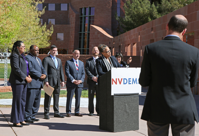 Assemblywoman Dina Neal, D-North Las Vegas, center, speaks to the news media prior to filing to run for re-election for her Assembly District 7 seat at Clark County Government Center Friday, March ...
