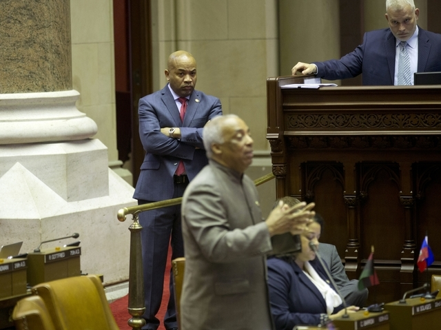 Assembly Speaker Carl Heastie, D-Bronx, left, looks on as Assemblyman Charles Barron, D-Brooklyn, speaks against a mixed martial arts bill in the Assembly Chamber at the Capitol on Tuesday, March  ...