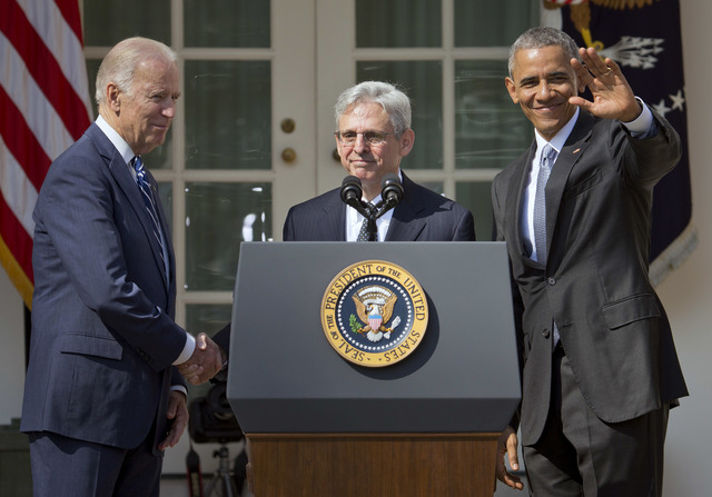 Federal appeals court judge Merrick Garland, center, stands with President Barack Obama and Vice President Joe Biden as he is introduced as Obama's nominee for the Supreme Court during an announce ...