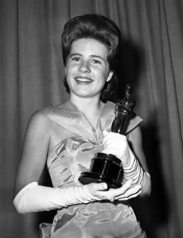 "Patty Duke, named best supporting actress of the year for her role in ""The Miracle Worker,"" poses with her award after the Academy Award ceremony in Santa Monica, Calif., April 8, 1963. Duke died  ..."