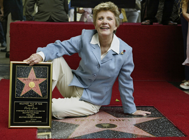 Actress Patty Duke is honored with a star on the Hollywood Walk of Fame in Los Angeles,  Aug. 17, 2004. Duke, who won an Oscar as a child at the start of an acting career that continued through he ...