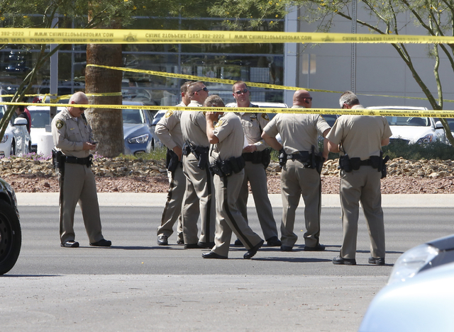 Las Vegas police is investigating a shooting near the intersection of Sahara Avenue and Lindell Road on Friday, July 10, 2015. A Las Vegas police officer was wounded and another person is dead aft ...