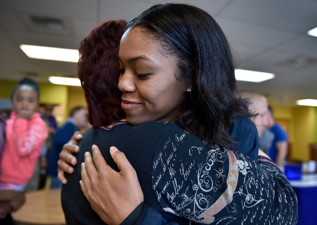 Bishop Gorman high jumper Vashti Cunningham, right, receives a hug from Cheryl Kuchka after a news conference at Remnant Ministries Monday, March 21, 2016, in Las Vegas. Cunningham announced she i ...