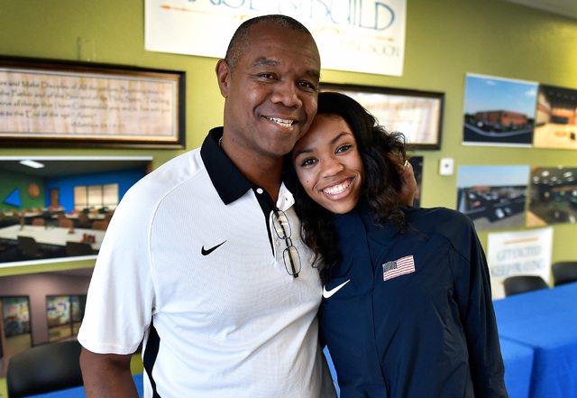 Bishop Gorman high jumper Vashti Cunningham, right, and her father, former UNLV and NFL quarterback Randall Cunningham, are all smiles after a news conference at Remnant Ministries Monday, March 2 ...