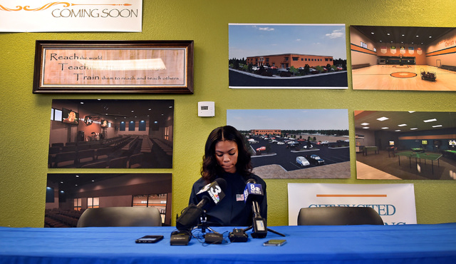 Bishop Gorman high jumper Vashti Cunningham reviews her notes at a news conference at Remnant Ministries Monday, March 21, 2016, in Las Vegas. Cunningham announced she is turning professional by s ...