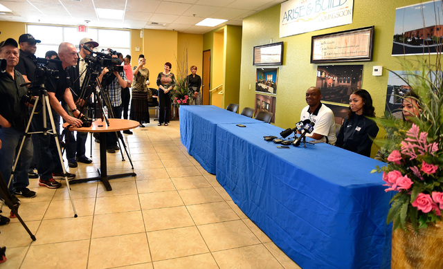 Bishop Gorman high jumper Vashti Cunningham, right, with her father, former UNLV and NFL quarterback Randall Cunningham attend a news conference at Remnant Ministries Monday, March 21, 2016, in La ...