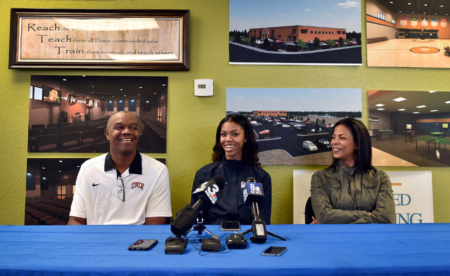 Bishop Gorman high jumper Vashti Cunningham, sits between her father, Randall Cunningham, left, and mother Felicity Cunningham at a news conference at Remnant Ministries Monday, March 21, 2016, in ...
