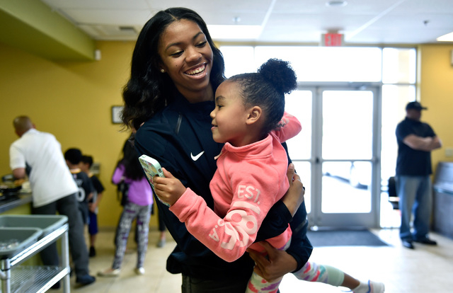 Bishop Gorman high jumper Vashti Cunningham plays with her younger sister, Sofia Cunningham, after a news conference at Remnant Ministries Monday, March 21, 2016, in Las Vegas. Vashti Cunningham a ...
