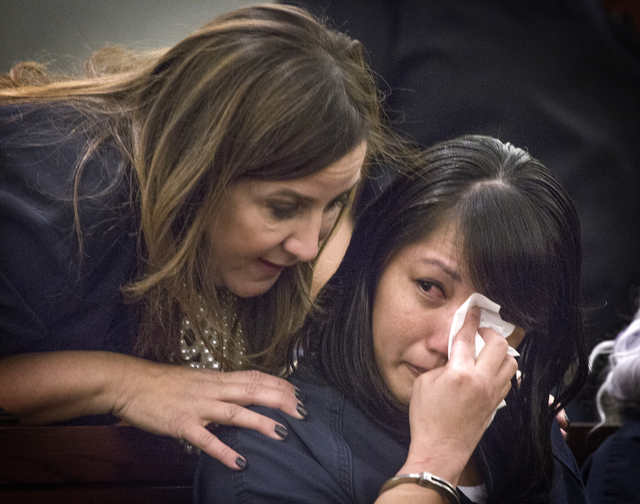 Michelle Paet cries while her attorney Kristina Wildeveld talks to her during her sentencing at Regional Justice Center on Thursday, March 3, 2016. She received life in prison for killing her husb ...