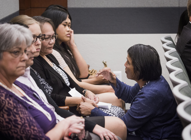 Constance Quintanilla, right, a relative of defendant Michelle Paet, comforts Carmelita Paet, the mother of slain  Nellis Airman Nathan,  during the sentencing of Michelle Paet at Regional Justice ...