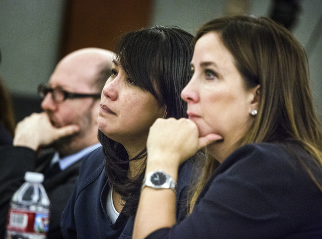 Defendant Michelle Paet, with her attorneys Dayvid Figler, left, and Cristina Wildeveld listens during her sentencing at Regional Justice Center on Thursday, March 3, 2016. Paet received life in p ...