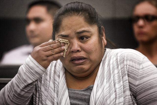 Melissa Sagiao, cries during sentencing of her sister Michelle Paet at Regional Justice Center on Thursday, March 3, 2016. Paet received life in prison for killing her husband  Nellis Airman Natha ...