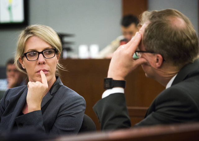 Prosecutors Michelle Fleck,left,  and Frank Coumou confer during the sentencing of Michelle Paet at Regional Justice Center on Thursday, March 3, 2016. Paet received life in prison for killing her ...