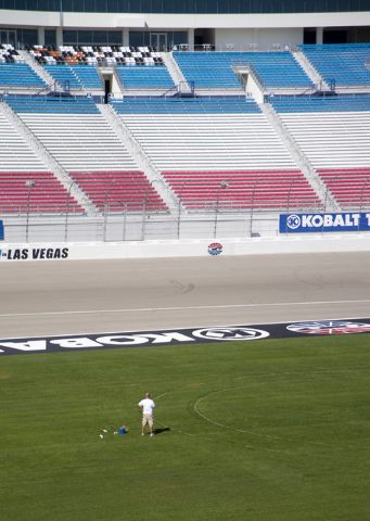 Dale Pantelakis, of Sport Designs International, marks out the main logo for the Kobalt Tools 400 on the grass in front of the grandstands at Las Vegas Motor Speedway on Wed, Feb. 24, 2016. Offici ...