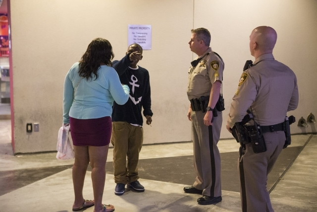 A couple with personal problems are assisted by Las Vegas police Sgt. William Jones, left, and Sgt. Bill Steinmetz near Planet Hollywood casino-hotel on Friday, Feb. 12, 2016, in Las Vegas. Erik V ...