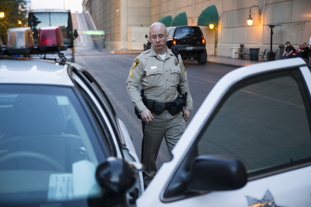 Las Vegas police Sgt. Bill Steinmetz walks to his patrol car at Bally's casino-hotel during his afternoon shift on Friday, Feb. 12, 2016, in Las Vegas. Erik Verduzco/Las Vegas Review-Journal Follo ...