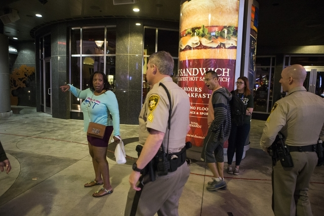 A woman asks Las Vegas police Sgt. William Jones, left, and Sgt. Bill Steinmetz for assistance near Planet Hollywood casino-hotel on Friday, Feb. 12, 2016, in Las Vegas. Erik Verduzco/Las Vegas Re ...