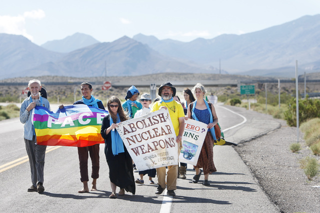 This file photo shows anti-nuclear weapons demonstrators approach the Nevada National Security Site during a civil disobedience action on Sept. 21, 2014.  (Sam Morris/Las Vegas Review-Journal)